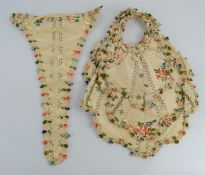 Two 19th century embroidery samples on silk, one of corset form embroidered with flowers and
