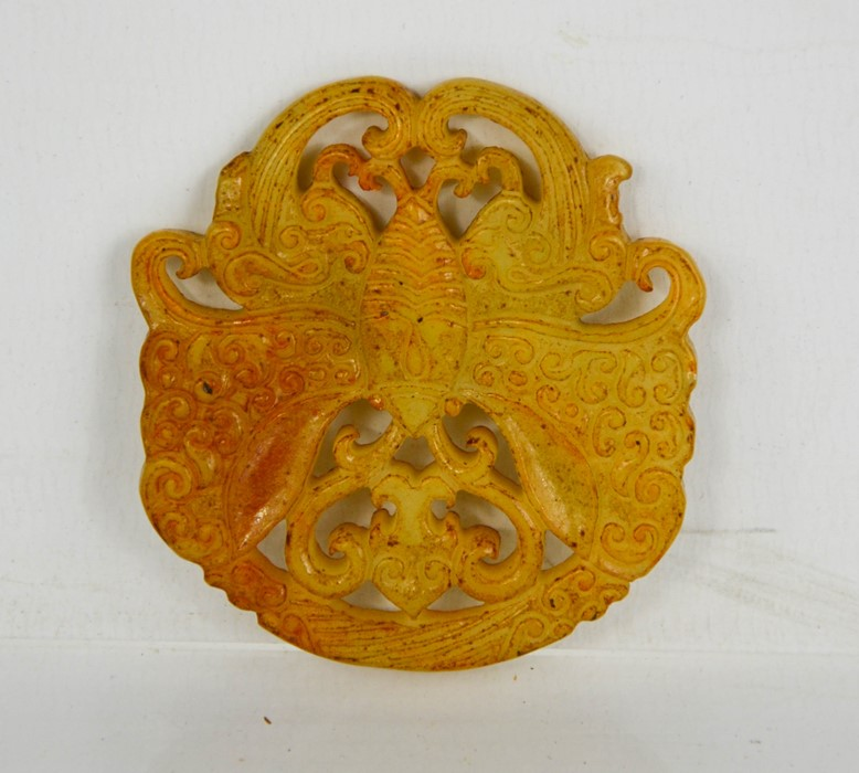 A Chinese natural jade hand carved bat pendant.