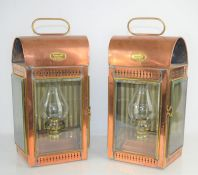 A pair of Davey and Co London Ltd copper ships cabin lanterns, 34cm
