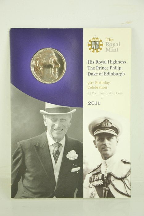 A Prince Philip 90th Birthday commemorative £5 coin in presentation pack.