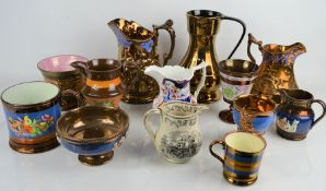 A quantity of Victorian lustre ware to include jugs tankards and goblets and a black and white
