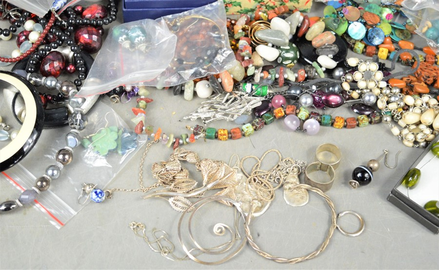 A large quantity of jewellery to include brooches, earrings, pocket watch, necklaces, some silver - Image 3 of 3
