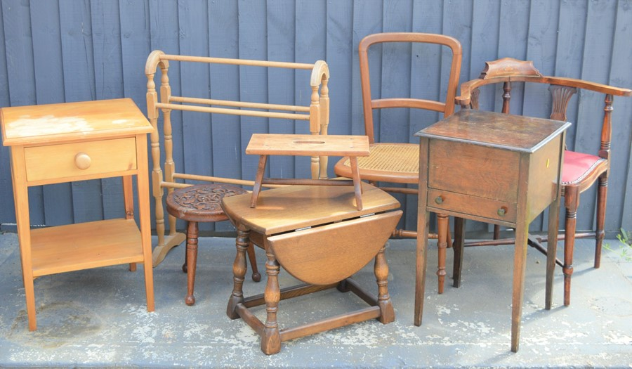 A group of furniture to include an Edwardian corner chair, tables, pine towel rail, stools etc