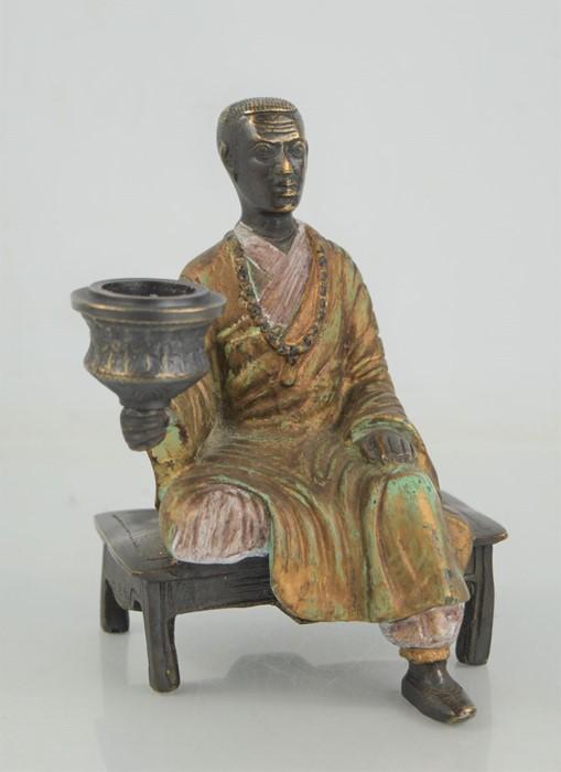 A 19th century bronze candlestick.