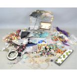 A large quantity of jewellery to include brooches, earrings, pocket watch, necklaces, some silver