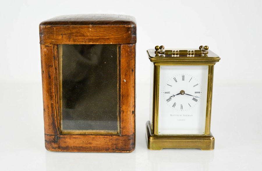 A Matthew Norman of London brass carriage clock with case.