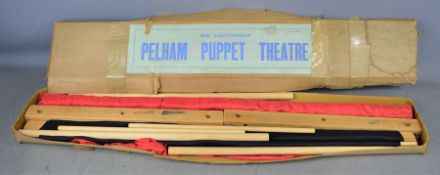 A vintage Pelham puppet lightweight theatre in original box