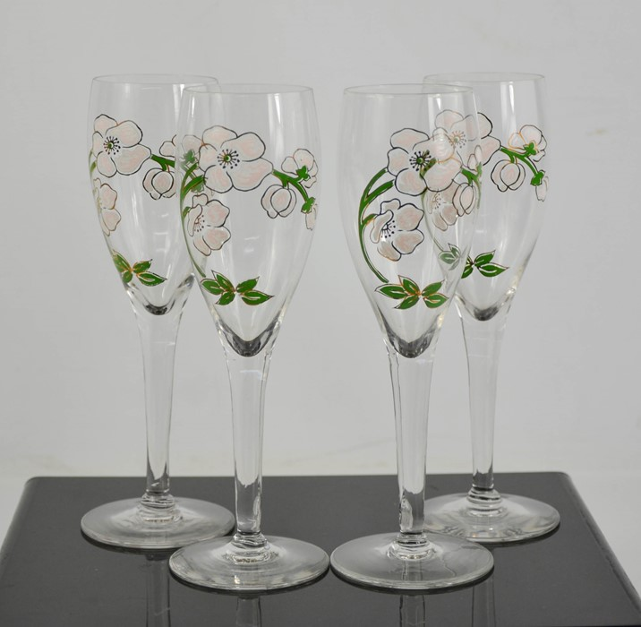 Four Perrier Jouet Champagne flutes.