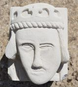 A hand-carved Portland stone corbel depicting a bishops head in the medieval style, carved by