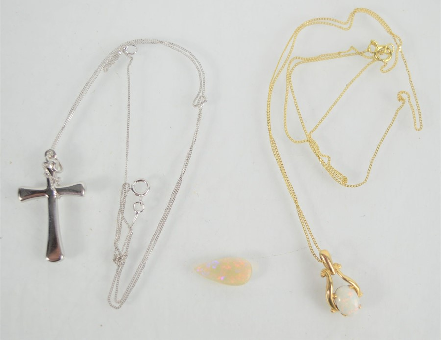 A 9ct white gold necklace and crucifix pendant together with a 9ct opal pendant and necklace and a