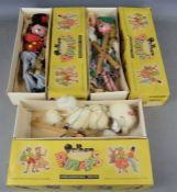 Three vintage Pelham puppets in original boxes to include Tyrolean girl, poodle etc