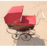 A child's Silver Cross pram and bedding.