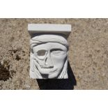 """A hand-carved Portland stone corbel """"my mortarium"""" carved by local artist Timothy Ennis"""