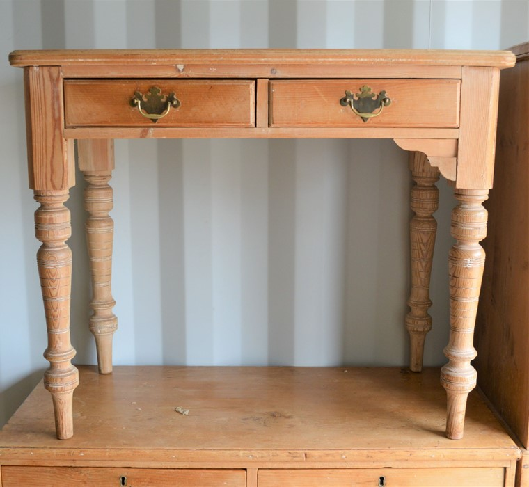 A pine two drawer hall table, 75cm high by 91cm wide by 48cm