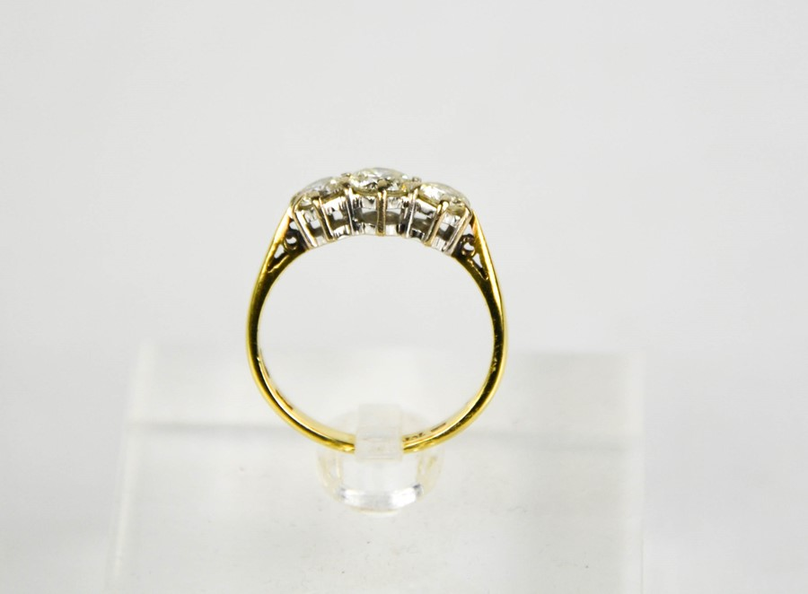 An 18ct gold three stone diamond trilogy ring, 1ct total diamond weight, size L½, 3g. - Image 5 of 5