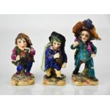 Three 19th century Dresden porcelain dwarf figurines, two playing musical instruments, and one