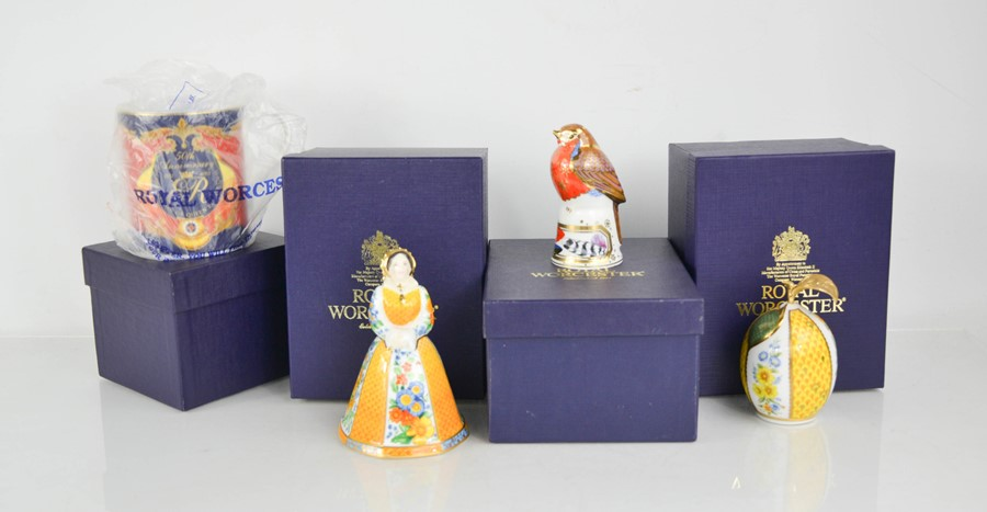 Three Royal Worcester candle snuffers and a Royal Worcester 50th Anniversary mug, all boxed.