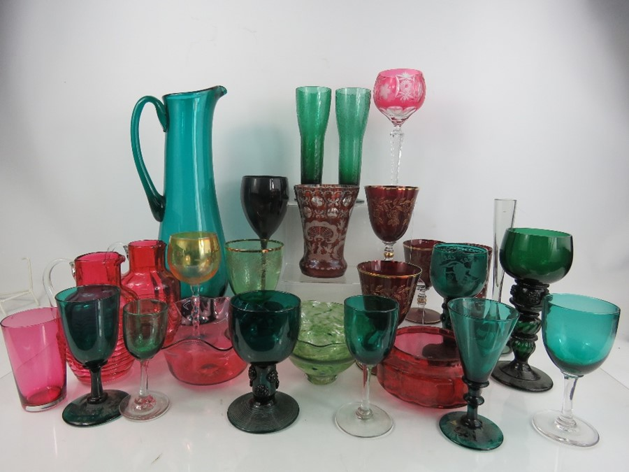 A quantity of glassware to include two Bohemian examples, retro glasses and jug in green and a