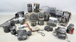 A group of vintage cameras and lens and accessories to include ICA Dresden folding camera, Asahi