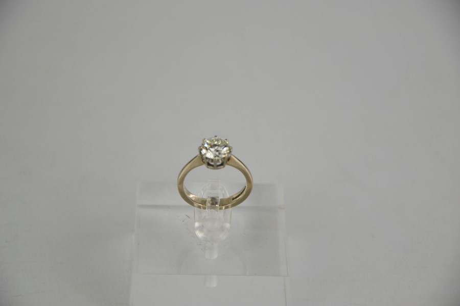 An 18ct white gold diamond solitaire, 1.57ct diamond approximately, size J, colour IJ, SI2, 4.1g. - Image 4 of 5
