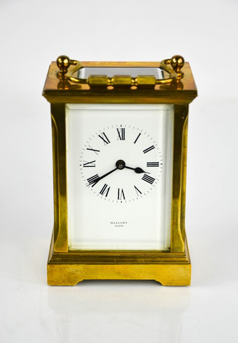 A Mallory of Bath brass carriage clock with Roman numeral dial, 12cm high.
