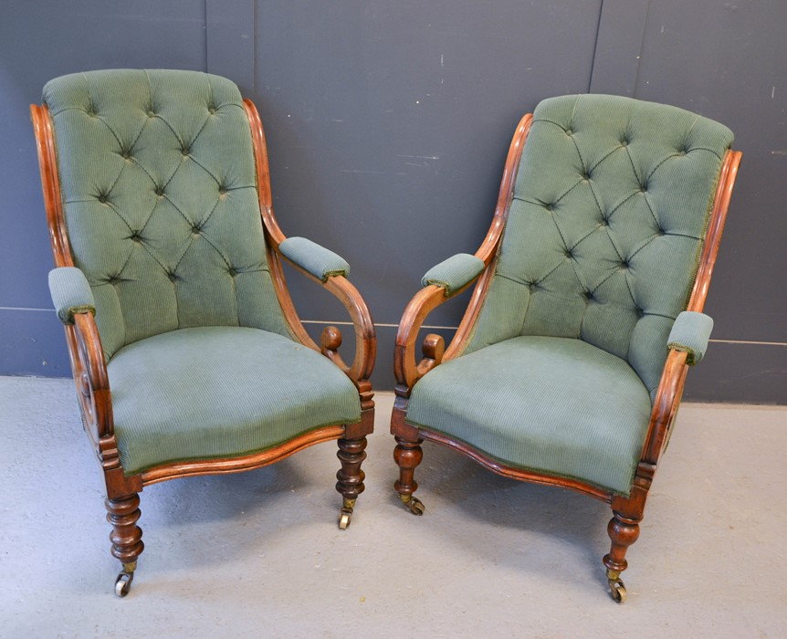 A pair of 19th century William IV mahogany chairs, with scroll arms, serpentine seat fronts,