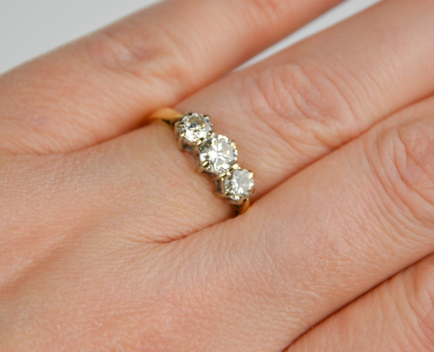 An 18ct gold three stone diamond trilogy ring, 1ct total diamond weight, size L½, 3g. - Image 2 of 5