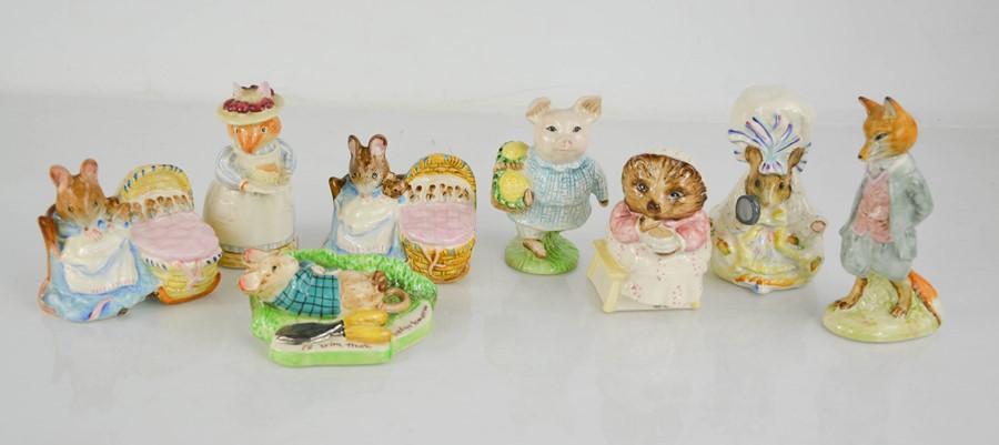 Eight Royal Doulton Beatrix Potter figurines.