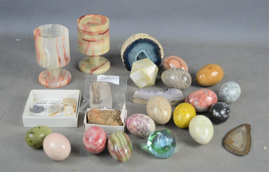 A quantity of agate eggs and two agate goblets a geode and amethyst slice