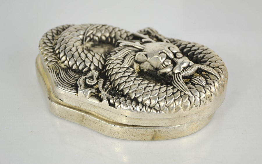 A Chinese Tibetan Miao silver ink box with carved dragon lid, 1125g.
