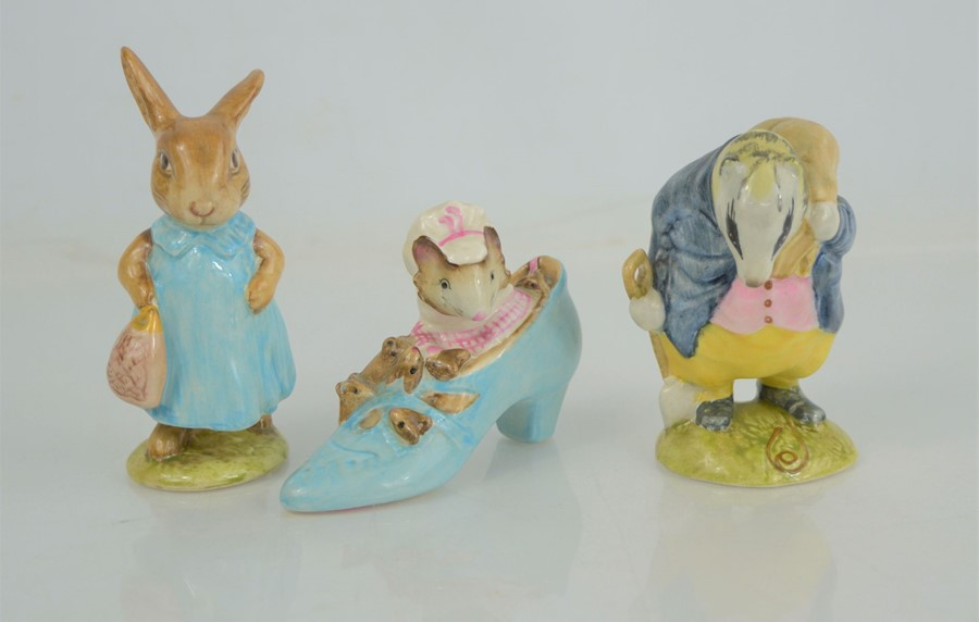 """Three Beswick Beatrix Potter figures """"The Old Woman who live in a Shoe"""" """"Tommy Brock"""" and """"Mrs"""