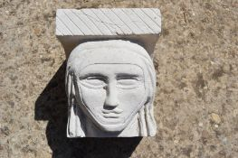 A hand-carved Portland stone corbel depicting a nuns head, carved by local artist Timothy Ennis