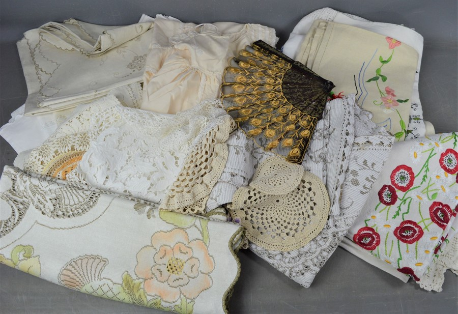 A quantity of linen, lace, a christening gown and a fan.