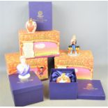Three Royal Doulton Harry Potter figurines together with three Royal Worcester candle snuffers all