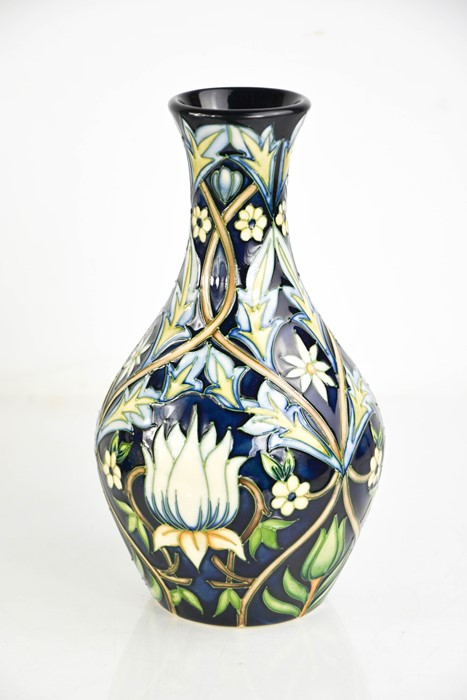 A Moorcroft vase, initialled MRJ to the base, and dated 2004.