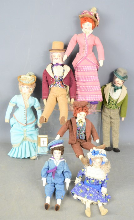 A group of American hand made dolls, all in traditional costume together with a miniature bible.