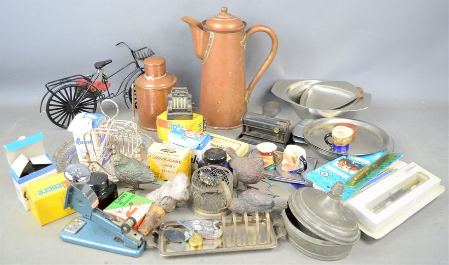 A group of vintage collectibles to include copper jug, silver plate toast rack, cigarette case,