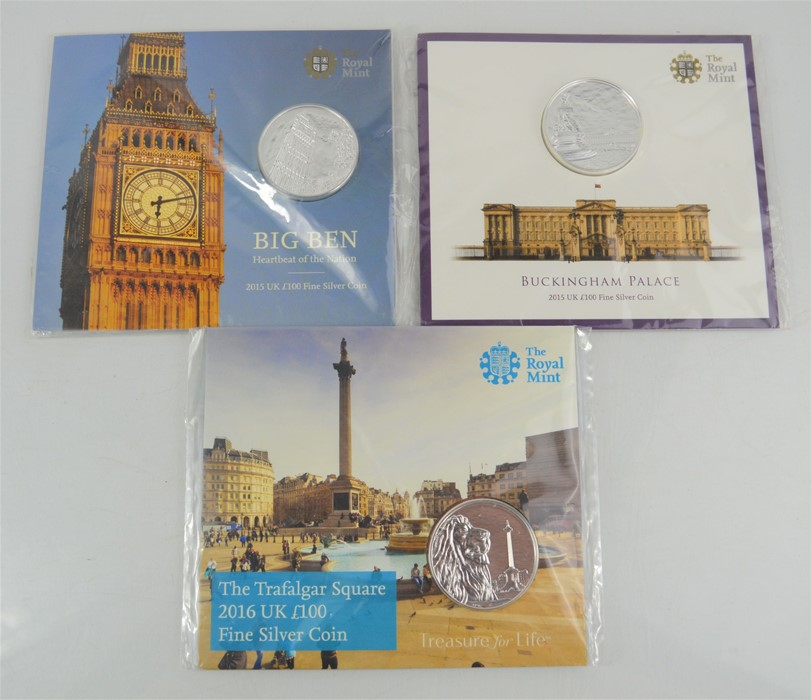 Three Royal Mint £100 uncirculated silver coins to include Big Ben, Trafalgar Square and