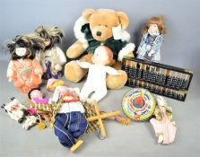 A group of vintage dolls and string puppets together with a Harrods teddy bear