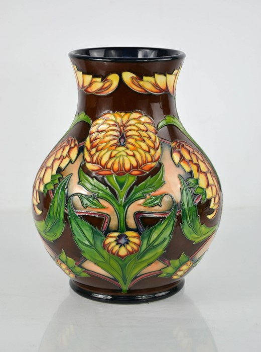 A Moorcroft limited edition vase designed by Philip Gibson, titled Dahlia, signed by the artist