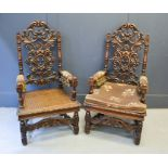 A pair of 19th century oak throne style armchairs, with carved scrollwork back, upholstered arms and