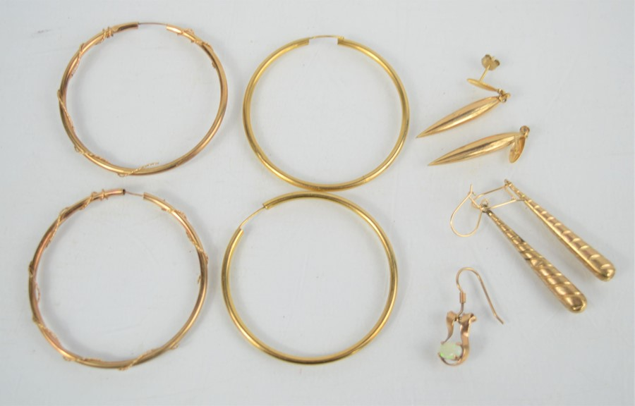 Two pairs of 9ct gold hoop earrings together with a pair of 9ct gold pointed pendant drop earrings