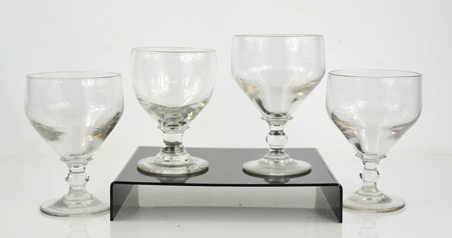 Four Georgian glasses, of varying size, with raised pontils to the base, 16cm high.