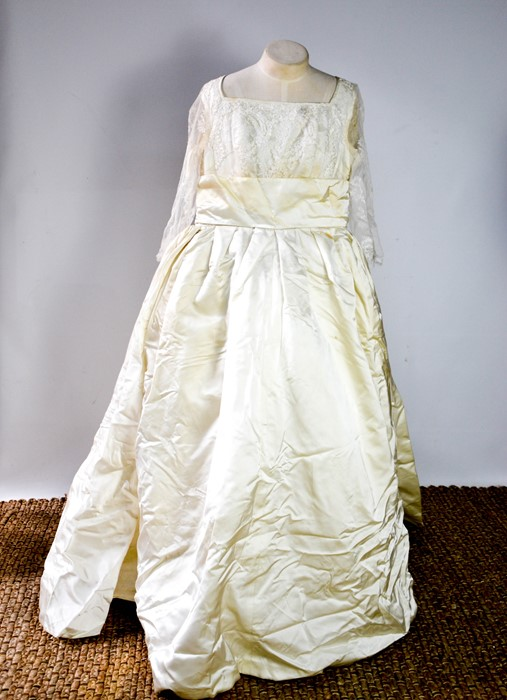 A silk and lace vintage wedding dress, with long sleeves.