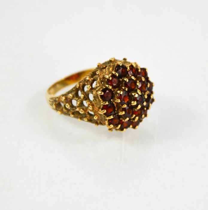 A 9ct gold and garnet cluster ring, size N, 7.4g.