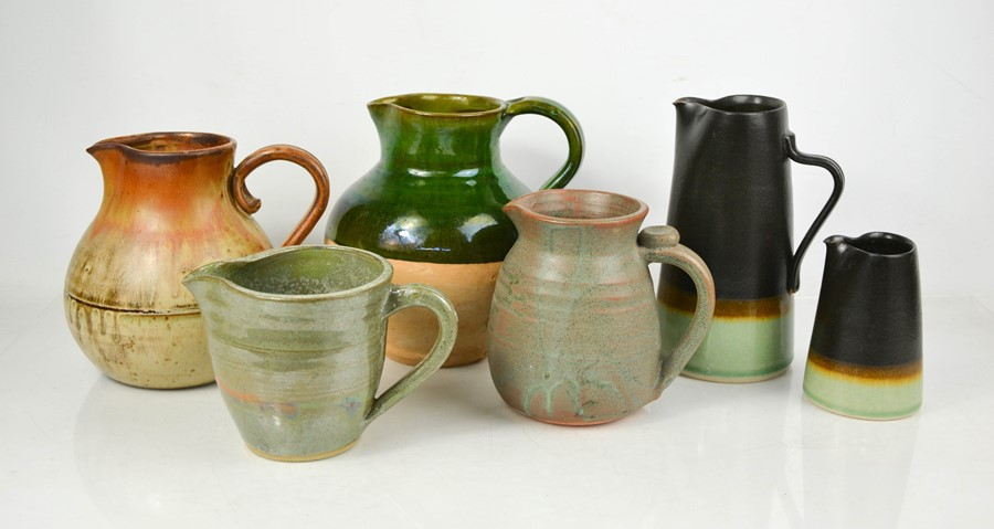 A group of studio pottery jugs, to include two by Petra Wright.