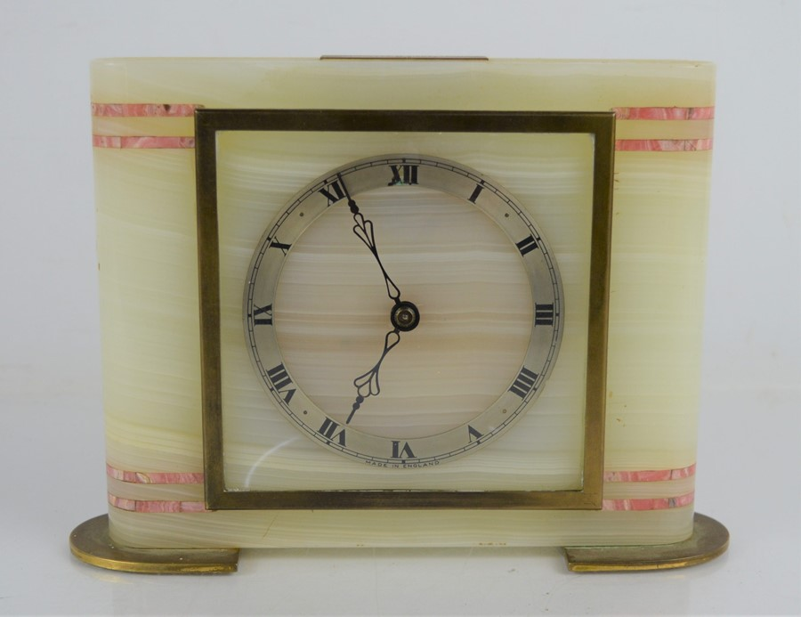 An art deco onyx and marble mantle clock, roman numeral dial 14cm