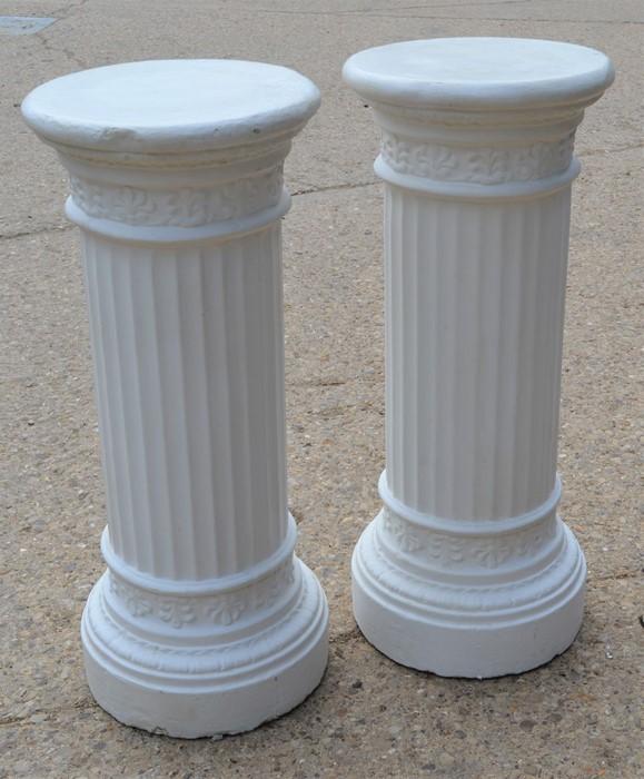 A pair of Corinthian style plaster columns 88cm high