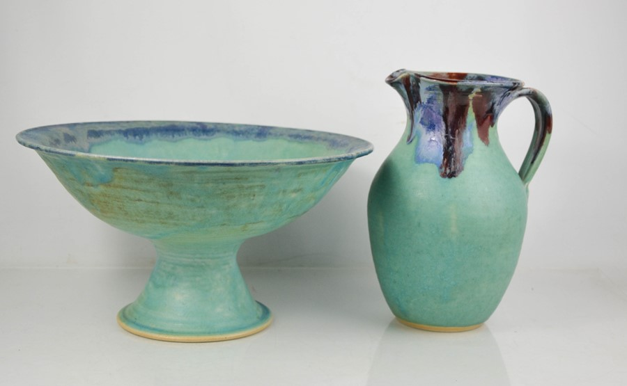 A Studio pottery jug and fruit bowl by Amberley Pottery, the jug 26cm high.