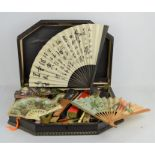 A wooden case together with a collection of vintage fans to include lace examples, with a group of
